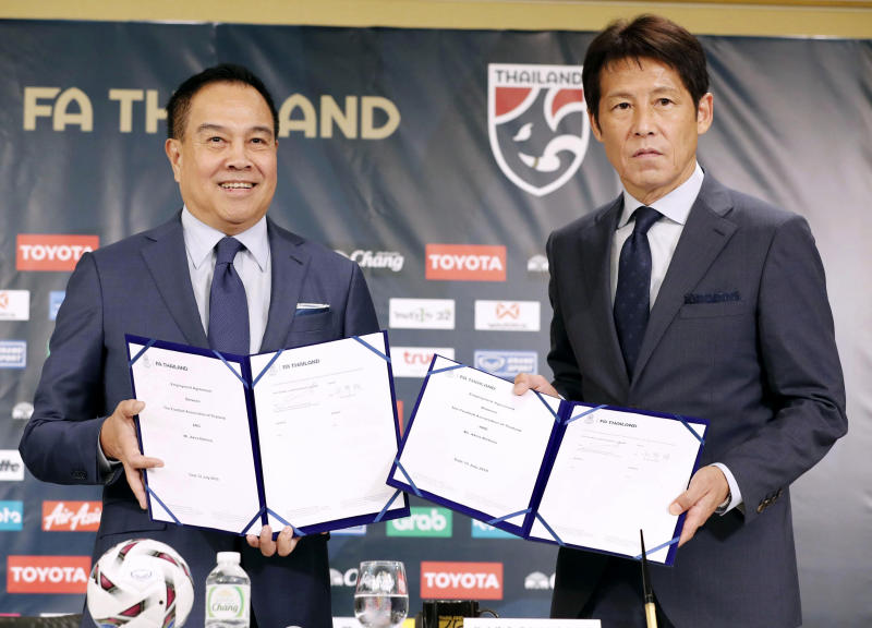 Former Japan manager Akira Nishino, right, and Thai Football Association president Somyot Pumpanmuang attend a press conference in Tokyo, Friday, July 19, 2019. Nishino was officially named head coach of the Thailand national and under-23 men's soccer teams on Wednesday. (Masanobu Kumagai/Kyodo News via AP)