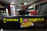 "Raed Bannura says the idea of setting up a snack bar named the ""Corona Sandwich"" struck him when he woke up one morning"