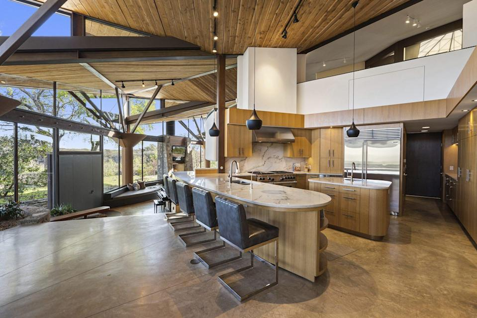 <p>Can't argue with those views while cooking — or the Calacatta Macaubas countertops, oak and maple cabinetry, and Sub-Sero and Wolf appliances.</p>