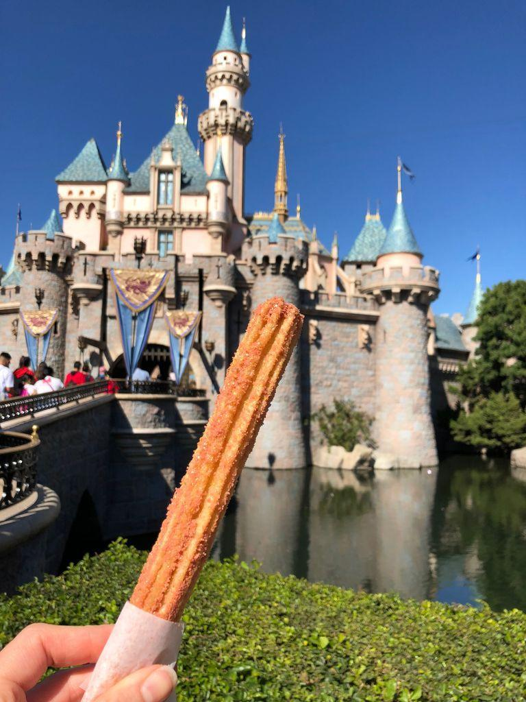 """<p>If you visit <a href=""""https://disneyland.disney.go.com/"""" rel=""""nofollow noopener"""" target=""""_blank"""" data-ylk=""""slk:Disneyland"""" class=""""link rapid-noclick-resp"""">Disneyland</a>, you have to check out the churros. They're notoriously sweet and delicious.</p>"""