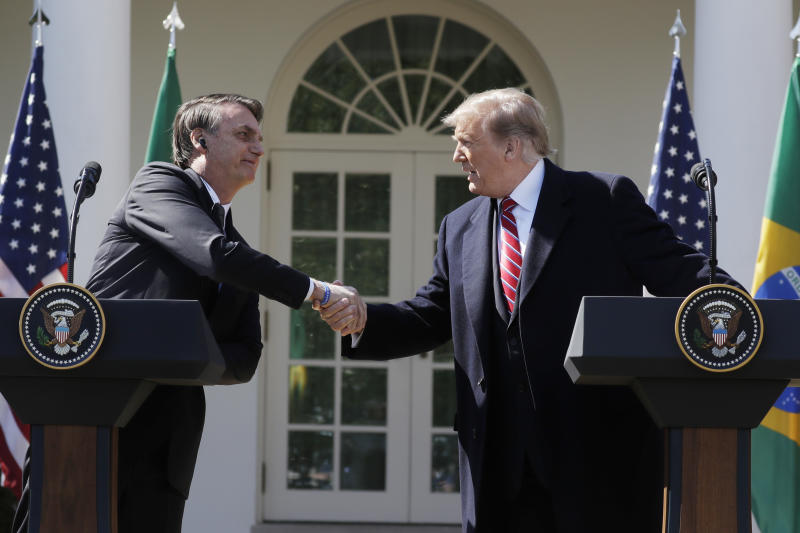 President Donald Trump greets Brazilian President Jair Bolsonaro during a news conference in the Rose Garden of the White House, Tuesday, March 19, 2019, in Washington. (AP Photo/Evan Vucci)