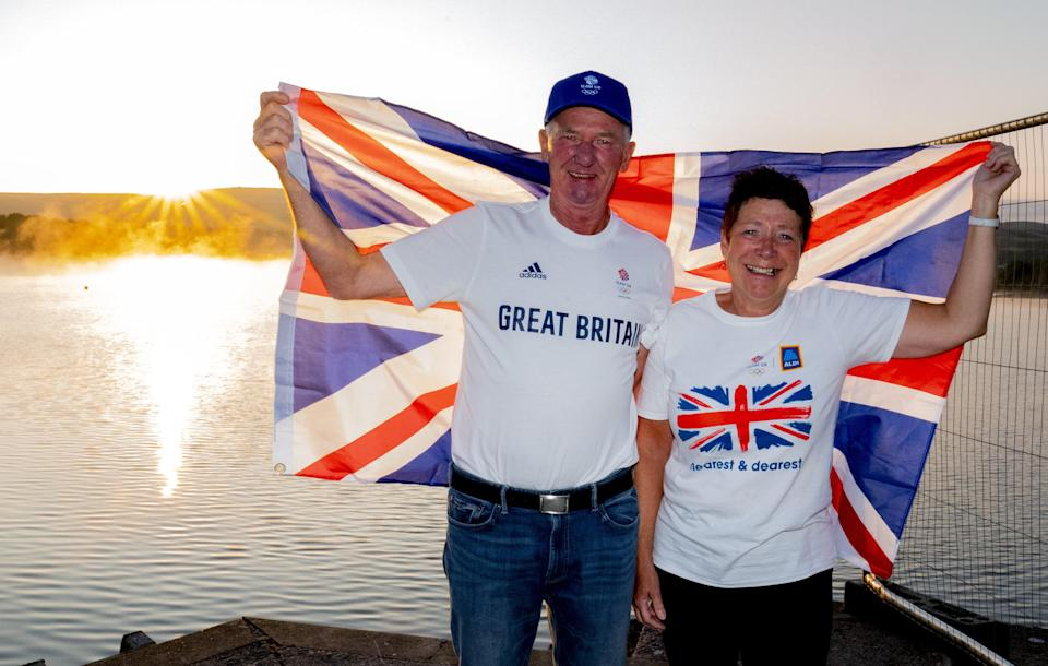 Leslie and Vivian Bithell celebrate after their son Stuart Bithell and his helm Dylan Fletcher won a gold medal in the 49er medal race during the Tokyo 2020 Olympic Games, at Bithell's home club, Hollingworth Lake Sailing Club, near Rochdale. Picture date: Tuesday August 3, 2021. (PA Wire)