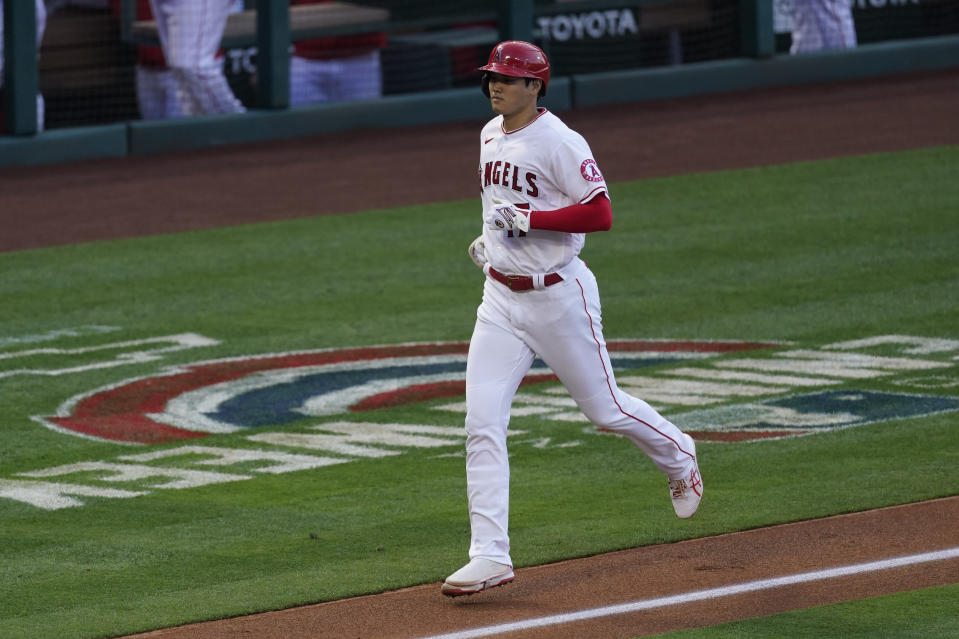 Los Angeles Angels starting pitcher Shohei Ohtani (17) runs the bases after hitting a home run during the first inning of a baseball game against the Chicago White Sox Sunday, April 4, 2021, in Anaheim, Calif. (AP Photo/Ashley Landis)