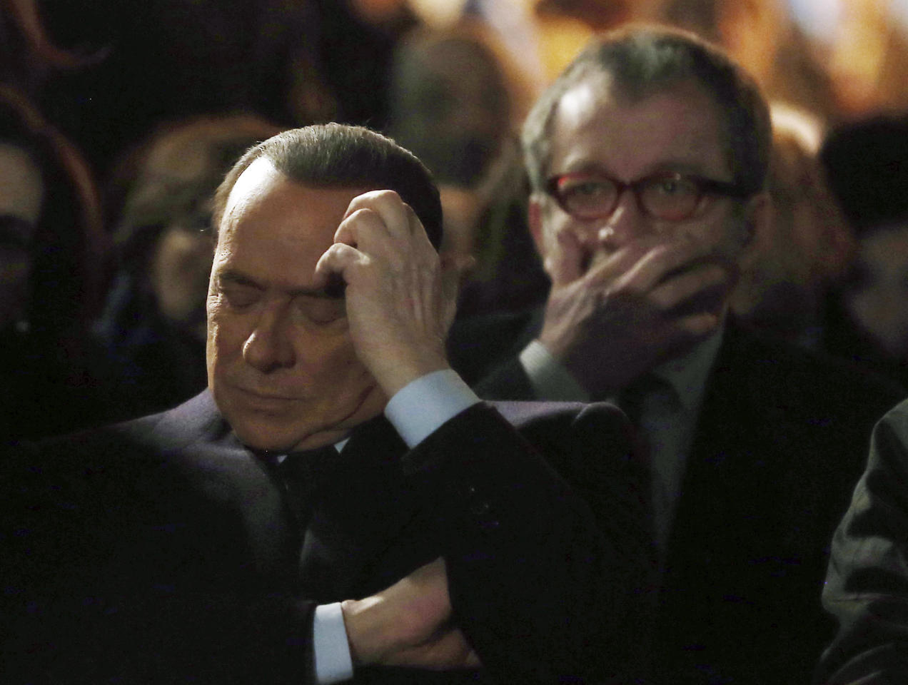 "Former Italian Premier Silvio Berlusconi, foreground, sits in front of Norther League party's leader Roberto Maroni in Milan, Italy, Sunday, Jan. 27, 2013. Silvio Berlusconi says Benito Mussolini did much good, except for dictator's regime's anti-Jewish laws. Berlusconi also defended Mussolini for siding with Hitler, saying the late fascist leader likely reasoned that German power would expand so it would be better for Italy to ally itself with Germany. He was speaking to reporters Sunday on the sidelines of a ceremony in Milan to commemorate the Holocaust. When Germany's Nazi regime occupied Italy during World War II, thousands from the tiny Italian Jewish community were deported to death camps. In 1938, before the war's outbreak, Mussolini's regime passed anti-Jewish laws, barring them from universities and many professions, among other bans. Berlusconi called the laws Mussolini's ""worst fault"" but insisted that in many other things, ""he did good."" (AP Photo/Antonio Calanni)"