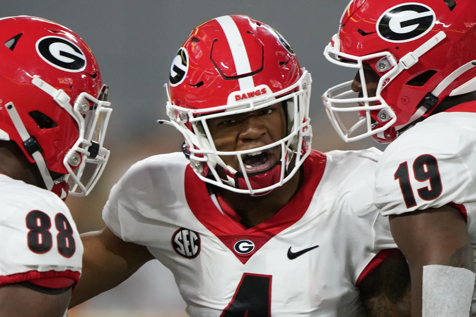 Georgia linebacker Nolan Smith, center, celebrates after sacking Clemson quarterback D.J. Uiagalelei during the first half of an NCAA college football game Saturday, Sept. 4, 2021, in Charlotte, N.C. (AP Photo/Chris Carlson)