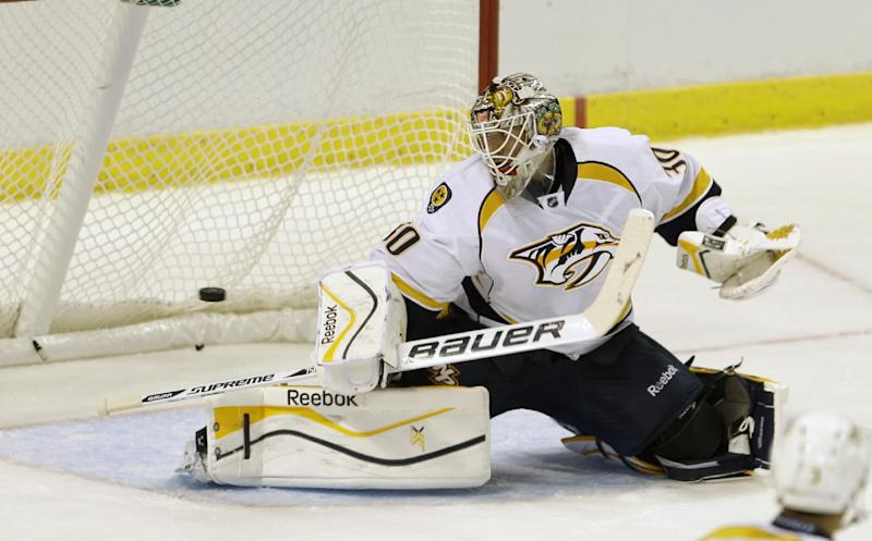Nashville Predators goalie Carter Hutton (30) is unable to stop the game-winning goal, 3-2, by Florida Panthers center Tomas Fleischmann (14) in overtime of an NHL preseason hockey game, Monday, Sept. 16, 2013, in Sunrise, Fla. (AP Photo/Alan Diaz)
