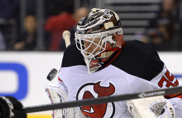 New Jersey Devils goalie Cory Schneider stops a shot during the second period of an NHL hockey game against the Los Angeles Kings, Thursday, Nov. 21, 2013, in Los Angeles. (AP Photo/Mark J. Terrill)