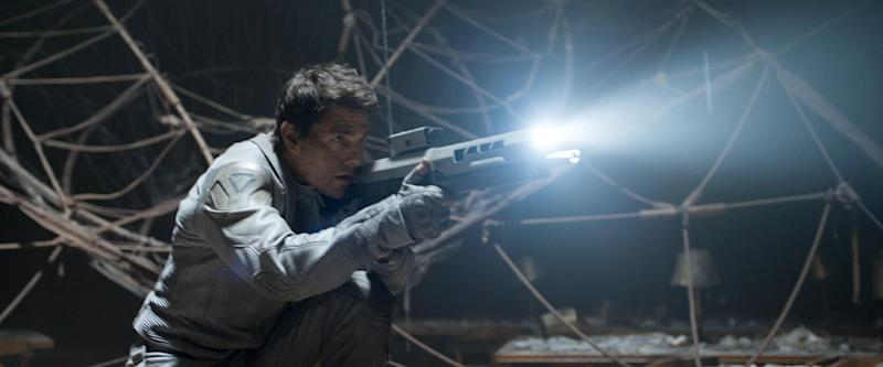 """This film publicity image released by Universal Pictures shows Tom Cruise in a scene from """"Oblivion."""" (AP Photo/Universal Pictures)"""
