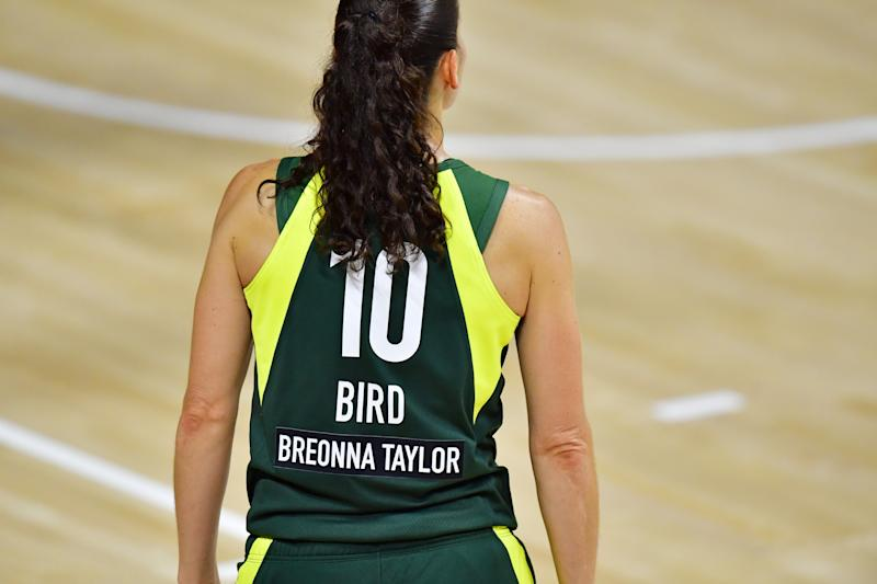 "The back of a WNBA jersey with the name ""Breonna Taylor"" on it."
