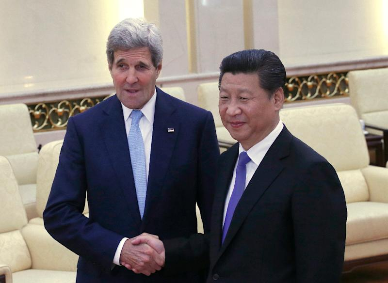 US Secretary of State John Kerry (L) shakes hands with Chinese President Xi Jinping at the Great Hall of the People in Beijing on May 17, 2015