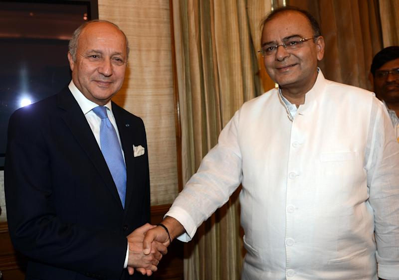 French Foreign Minister Laurent Fabius (left) shakes hands with India's Defence and Finance Minister Arun Jaitley during a meeting in New Delhi, on June 30, 2014