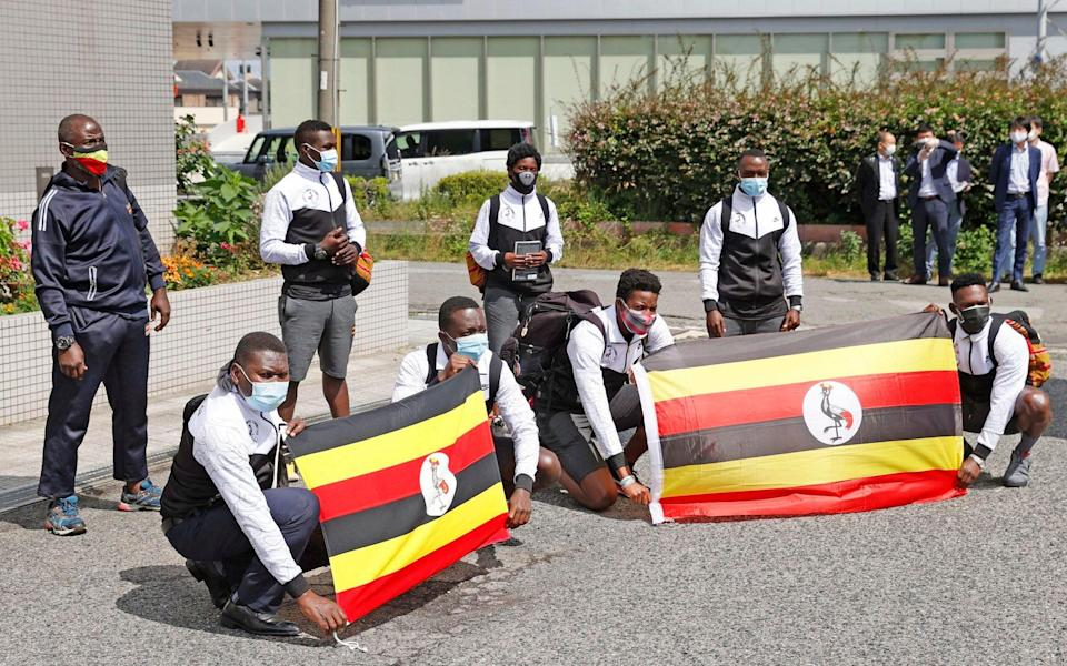Members of Uganda's Olympic team pose for a photo on their arrival at their host town Izumisano, Osaka, in western Japan on Sunday - Suo Takekuma/Kyodo News