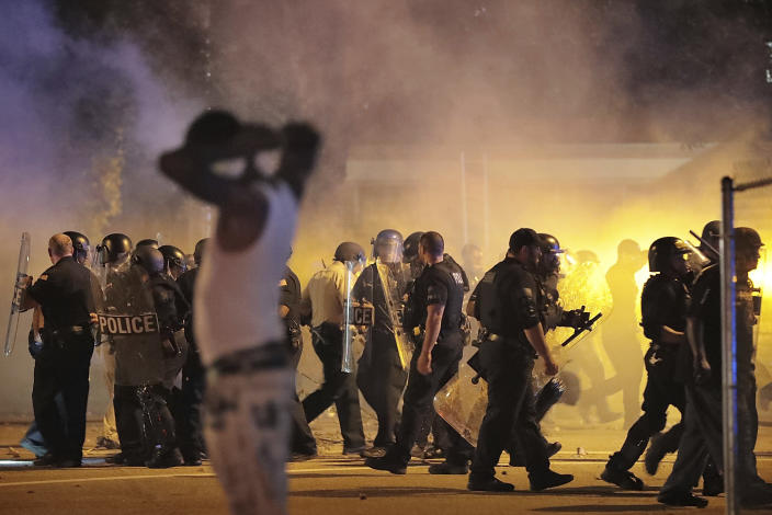 Police retreat under a cloud of tear gas as protesters disperse from the scene of a standoff after Frayser community residents took to the streets in anger against the shooting of a youth by U.S. Marshals earlier in the evening, Wednesday, June 12, 2019, in Memphis, Tenn. (Photo: Jim Weber/Daily Memphian via AP)