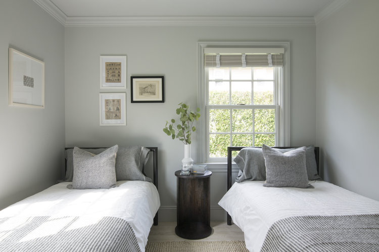 <p>Gargano layered new accent pillows and throw blankets in luxe merino wool to make this airy bedroom look and feel cozy. </p>