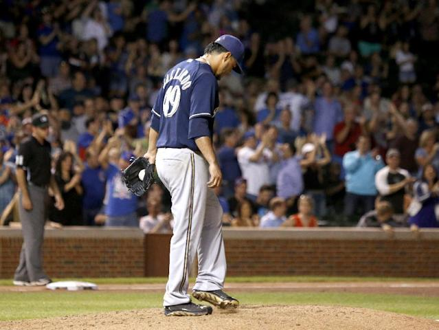 Milwaukee Brewers starting pitcher Yovani Gallardo returns to the mound after giving up a two-run home run to Chicago Cubs' Arismendy Alcantara, also scoring Welington Castillo, during the fifth inning of a baseball game Tuesday, Sept. 2, 2014, in Chicago. (AP Photo/Charles Rex Arbogast)
