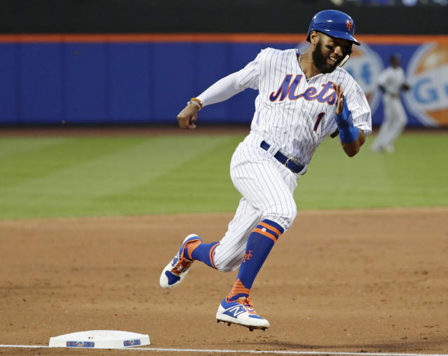 New York Mets' Amed Rosario passes third base on his way to home plate to score on a double by Asdrubal Cabrera during the third inning of a baseball game against the Miami Marlins Monday, May 21, 2018, in New York. (AP Photo/Frank Franklin II)