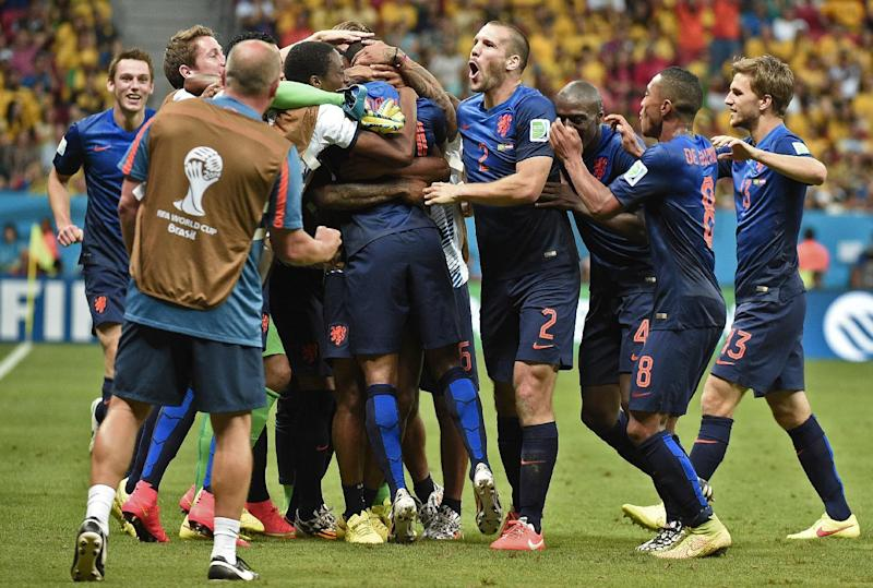Netherlands' players celebrate scoring during the third place play-off football match between Brazil and Netherlands during the World Cup at the National Stadium in Brasilia on July 12, 2014 (AFP Photo/Damien Meyer)