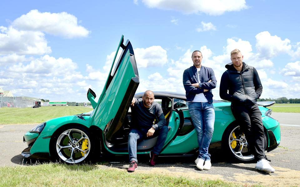 EMBARGOED TO 0001 MONDAY JUNE 10 (left to right) Chris Harris, Paddy McGuinness and Freddie Flintoff with a McLaren 600LT on the Top Gear test track in Dunsfold Park, Cranleigh, during the media launch for the new series of Top Gear which airs later this month.