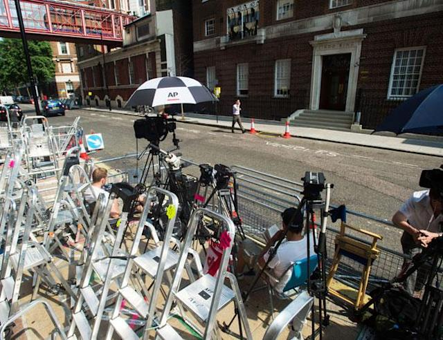 LONDON, UNITED KINGDOM - JULY 8: Members of the press set up outside the The Lindo Wing of St Mary's Hospital as the UK prepares for the birth of the first child of The Duke and Duchess of Cambridge at St Mary's Hospital on July 8, 2013 in London, England. (Photo by Samir Hussein/WireImage) <br>
