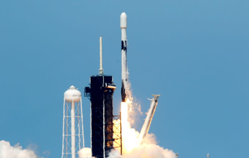 FILE PHOTO: A SpaceX Falcon 9 rocket lifts off from pad 39A with the seventh batch of SpaceX broadband network satellites, at the Kennedy Space Center, in Cape Canaveral