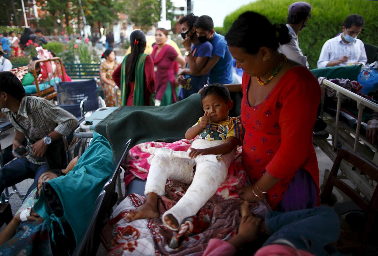 Earthquake victims are kept on the open ground for treatment after the earthquake, in Kathmandu, May 12, 2015. A 7.3 magnitude earthquake killed at least 37 people and spread panic in Nepal on Tuesday, bringing down buildings already weakened by a devastating tremor less than three weeks ago and unleashing landslides in Himalayan valleys near Mount Everest. The earthquake was centered 76 km (47 miles) east of the capital in a hilly area close to the border with Tibet, according to coordinates provided by the U.S. Geological Survey. REUTERS/Navesh Chitrakar