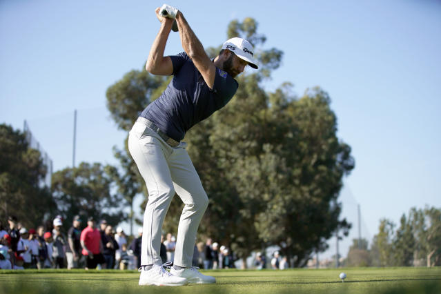 Dustin Johnson tees off on the second hole during the third round of the Genesis Invitational golf tournament at Riviera Country Club, Saturday, Feb. 15, 2020, in the Pacific Palisades area of Los Angeles. (AP Photo/Ryan Kang)
