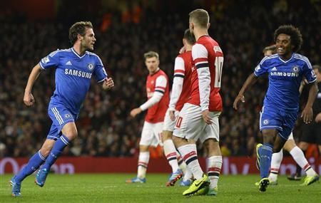 Chelsea's Mata celebrates scoring against Arsenal during their English League Cup fourth round soccer match at Emirates Stadium in London