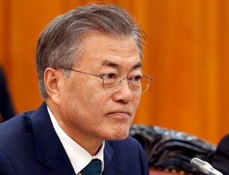 FILE PHOTO - South Korea's President Moon is seen during a meeting with Vietnam's PM Phuc in Hanoi