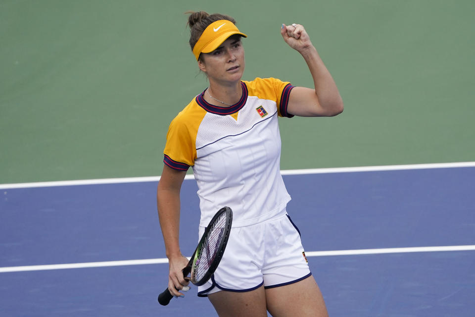 Elina Svitolina, of Ukraine, reacts after scoring a point against Daria Kasatkina, of Russia, during the third round of the US Open tennis championships, Friday, Sept. 3, 2021, in New York. (AP Photo/John Minchillo)
