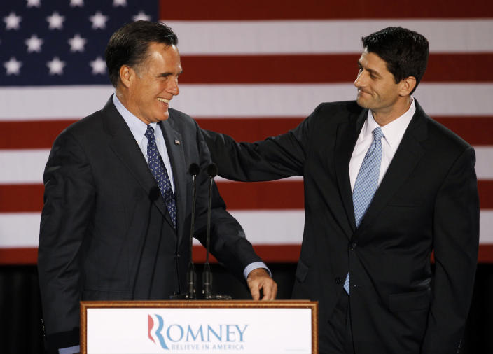 FILE - House Budget Committee Chairman Rep. Paul Ryan, R-Wis. introduces Republican presidential candidate, former Massachusetts Gov. Mitt Romney before Romney spoke at the Grain Exchange in Milwaukee, in this April 3, 2012 file photo. Romney has picked Wisconsin congressman Paul Ryan to be his running mate, according to a Republican with knowledge of the development. They will appear together Saturday Aug. 11, 2012 in Norfolk, Va., at the start of a four-state bus tour to introduce the newly minted GOP ticket to the nation. (AP Photo/M. Spencer Green, File)