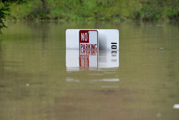 A No Parking sign is almost completely submerged in flood waters from the Russian River in Forestville, Calif., on Feb. 27, 2019. (Photo: Michael Short/AP)