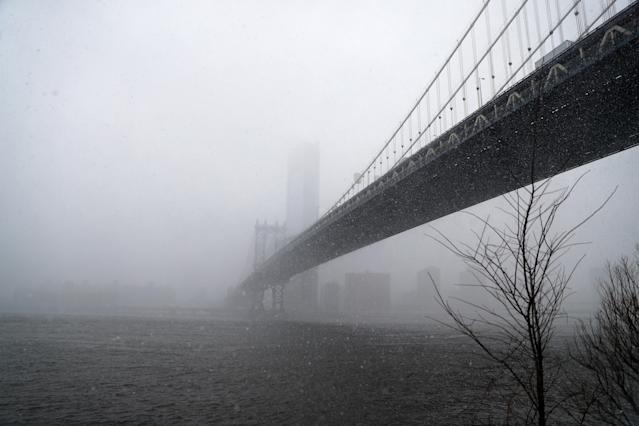 <p>A view of the Manhattan Bridge from the DUMBO section of Brooklyn, New York as a spring storm hit the area on March 21, 2018. (Photo: Gordon Donovan/Yahoo News) </p>
