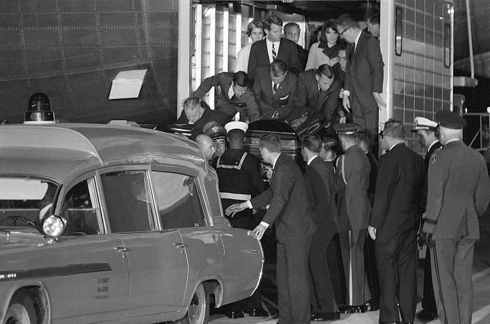 The casket containing the body of slain President John F. Kennedy is moved to a Navy ambulance from the Presidential plane which arrived from Dallas, Texas, where Kennedy was assassinated, to Andrews Air Force Base, Md. on Nov. 22, 1963. First Lady Jacqueline Kennedy is behind on the elevator. Attorney General Robert Kennedy, his brother, is beside her. Lawrence O'Brien of the White House staff is at the right. Secret Service men are directly behind the casket. (Photo: AP)