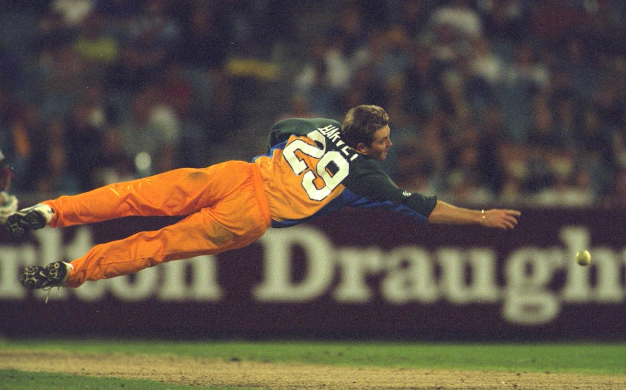 9 Feb 2001:  Ian Harvey of Australia dives for a catch in the second Final of the Carlton One Day International Series between Australia and the West Indies, played at the Melbourne Cricket Ground in Melbourne, Australia. Mandatory Credit: Hamish Blair/ALLSPORT