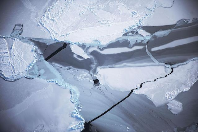 <p>Ice is viewed near the coast of West Antarctica from a window of a NASA Operation IceBridge airplane on Oct. 27, 2016 in flight over Antarctica. (Photo: Mario Tama/Getty Images) </p>