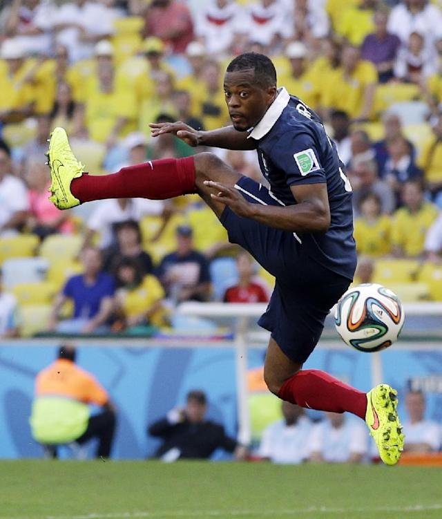 France's Patrice Evra leaps to stop a pass during the World Cup quarterfinal soccer match between Germany and France at the Maracana Stadium in Rio de Janeiro, Brazil, Friday, July 4, 2014. (AP Photo/Kirsty Wigglesworth)