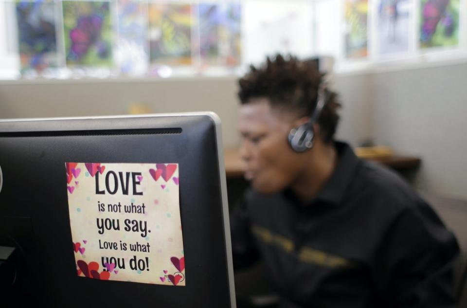 """<span class=""""caption"""">An advocate works in the National Domestic Violence Hotline center's facility in Austin, Texas.</span> <span class=""""attribution""""><a class=""""link rapid-noclick-resp"""" href=""""http://www.apimages.com/metadata/Index/Domestic-Violence-Hotline/d9825b895a8a44f7a3947240ce69d7fd/9/0"""" rel=""""nofollow noopener"""" target=""""_blank"""" data-ylk=""""slk:AP Photo/Eric Gay"""">AP Photo/Eric Gay</a></span>"""