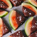 """<p>By mixing coconut oil into melted chocolate, you're basically making a magic shell. It's not a totally necessary step, but it does help the chocolate harden — meaning the dipped watermelon is ready to eat pretty much immediately. </p><p>Get the <a href=""""https://www.delish.com/uk/cooking/recipes/a33631883/chocolate-covered-watermelon-recipe/"""" rel=""""nofollow noopener"""" target=""""_blank"""" data-ylk=""""slk:Chocolate Covered Watermelon"""" class=""""link rapid-noclick-resp"""">Chocolate Covered Watermelon</a> recipe.</p>"""