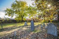 "<p>If you really want to get spooked, you can do a graveyard or ghost tour and learn about all of those who've been buried from the witch trials and beyond. The graveyards in Salem date back to the early 1600s, so you can imagine how unsettling the stones look. I recommend <a href=""https://www.salem.org/listing/candlelight-ghostly-graveyard/"" class=""link rapid-noclick-resp"" rel=""nofollow noopener"" target=""_blank"" data-ylk=""slk:the candlelight ghost tour"">the candlelight ghost tour</a>, as it sets the tone for a frightful night.</p>"