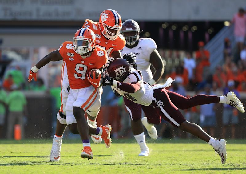 CLEMSON, SOUTH CAROLINA - SEPTEMBER 07: Keldrick Carper #14 of the Texas A&M Aggies tries to stop Travis Etienne #9 of the Clemson Tigers during their game at Memorial Stadium on September 07, 2019 in Clemson, South Carolina. (Photo by Streeter Lecka/Getty Images)