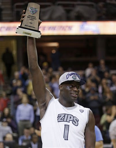 Akron's Demetrius Treadwell holds up the MVP trophy after an NCAA college championship basketball game in the Mid-American Conference men's tournament Saturday, March 16, 2013, in Cleveland. Akron defeated Ohio 65-46. (AP Photo/Tony Dejak)