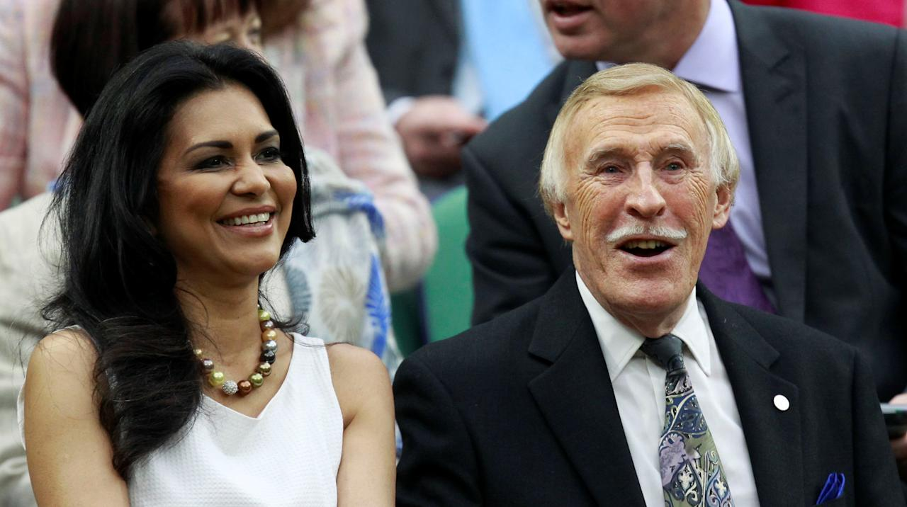 FILE PHOTO: British television personality Bruce Forsyth (R) sits with his wife, Wilnelia Merced, on Centre Court at the Wimbledon tennis championships in London June 22, 2011.     REUTERS/Suzanne Plunkett/File Photo