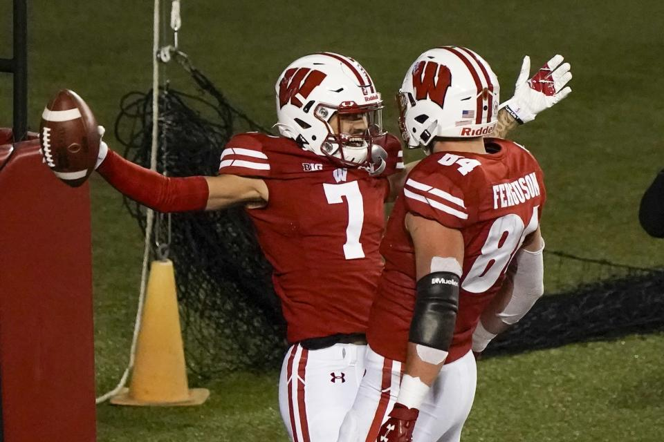 Wisconsin wide receiver Danny Davis III celebrates his touchdown catch with Jake Ferguson (84) during the first half of an NCAA college football game against Illinois Friday, Oct. 23, 2020, in Madison, Wis. (AP Photo/Morry Gash)
