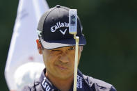 Kevin Na lines up his shot on the first green during the third round of the Tour Championship golf tournament Saturday, Sept. 4, 2021, at East Lake Golf Club in Atlanta. (AP Photo/Brynn Anderson)