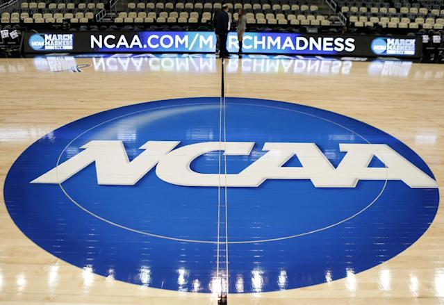 "The federal government dropped a bomb on college basketball Tuesday, <a href=""https://sports.yahoo.com/fbi-probe-uncovers-massive-college-basketball-scandal-snaring-big-time-programs-144631716.html"" data-ylk=""slk:indicting 10 men in a wide-spread fraud and bribery scheme;outcm:mb_qualified_link;_E:mb_qualified_link"" class=""link rapid-noclick-resp newsroom-embed-article"">indicting 10 men in a wide-spread fraud and bribery scheme</a>. (AP)"