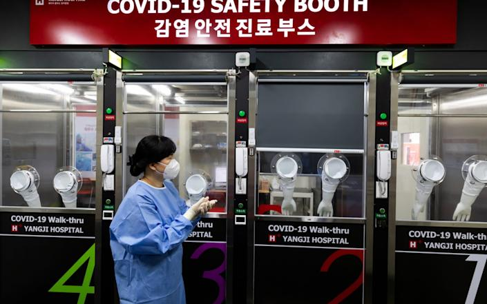 A medical worker at H Plus Yangji Hospital in Seoul - BLOOMBERG