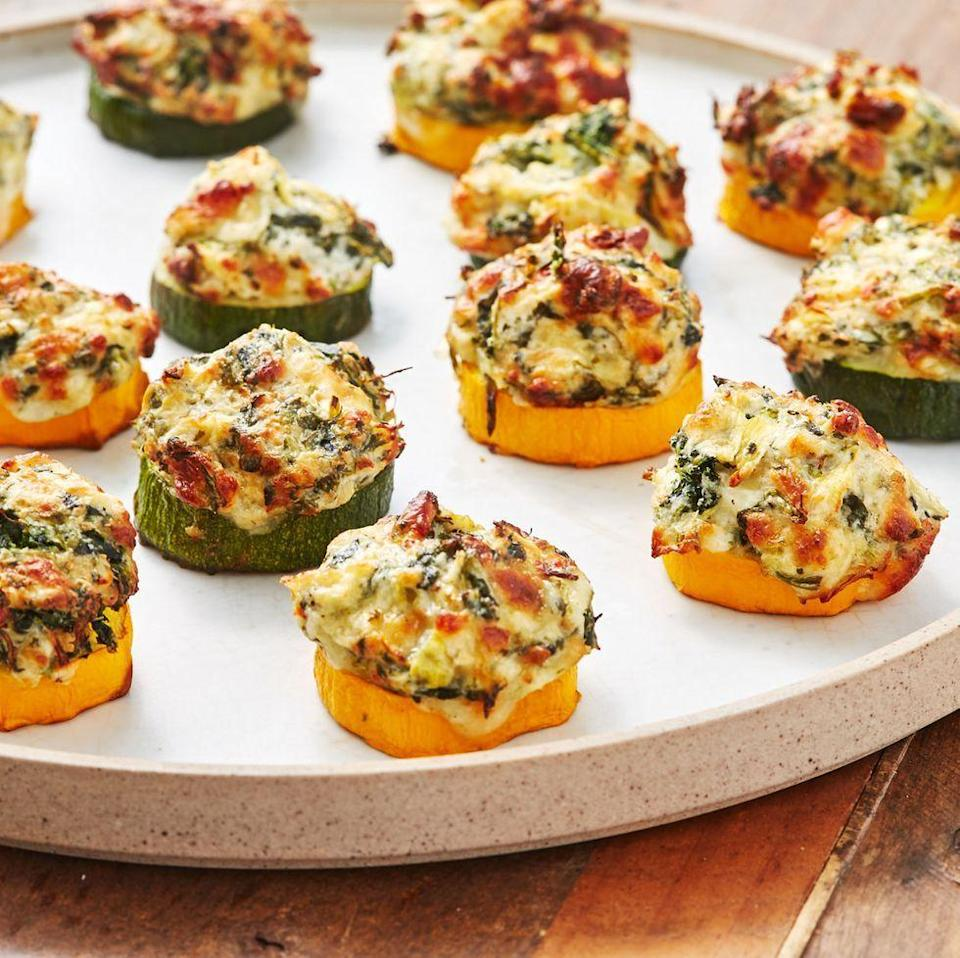 """<p>These little guys are scary addictive. Just as the courgette becomes tender, the cheese is getting melty and delicious. If you want a little extra colour on your bites, switch the oven to grill on medium and cook them a couple minutes more. (Just keep an eye on them.) </p><p>Get the <a href=""""https://www.delish.com/uk/cooking/recipes/a33664100/spinach-artichoke-zucchini-bites-recipe/"""" rel=""""nofollow noopener"""" target=""""_blank"""" data-ylk=""""slk:Spinach Artichoke Courgette Bites"""" class=""""link rapid-noclick-resp"""">Spinach Artichoke Courgette Bites</a> recipe.</p>"""
