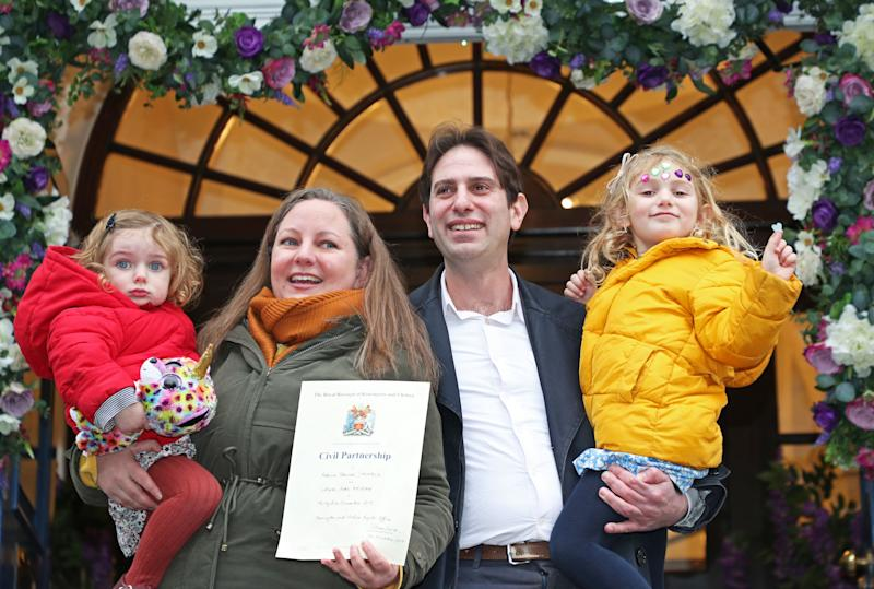 <strong>Rebecca Steinfeld and Charles Keidan, with their children Ariel and Eden, outside Kensington and Chelsea Register Office in King's Rd, Chelsea, London, after becoming one of the first couples to register for a civil partnership.</strong> (Photo: PA Wire/PA Images)