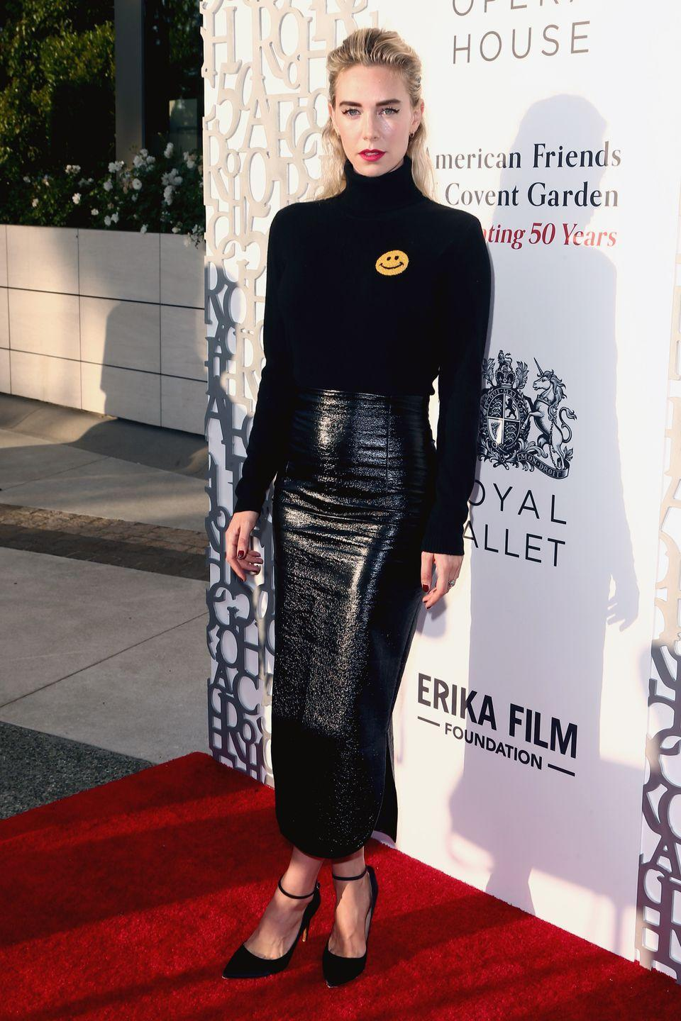 <p>Kirby styles a black pencil skirt with a graphic knit turtleneck and pink lipstick for a celebration at Jean-Georges Beverly Hills.</p>