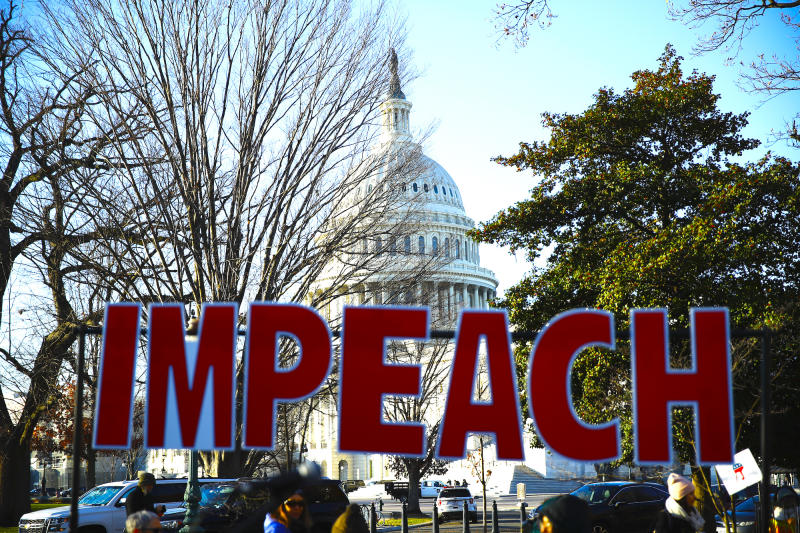 Protesters demonstrate as the House of Representatives begins debate on the articles of impeachment against President Donald Trump at the U.S. Capitol building, Wednesday, Dec. 18, 2019, on Capitol Hill in Washington. (AP Photo/Matt Rourke)